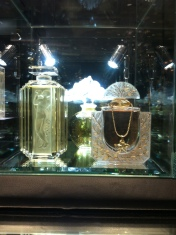 Beautiful dressing table must-haves. A perfume bottle wearing a necklace?? Adore it!