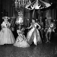 Daisy Fellowes, Paris Editor for American Harper's Bazaar, fashion icon and heiress to the Singer sewing machine fortune, arrived at the ball dressed as The Queen of Africa in a Christian Dior design. Photograph by Robert Doisneau.