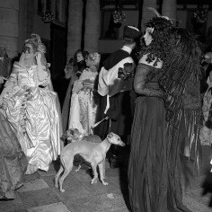 Surrealist artist, Leonor Fini, pictured right in black, creator of the iconic flacon for Elsa Schiaparelli's perfume Shocking. Photograph by Willy Rizzo.