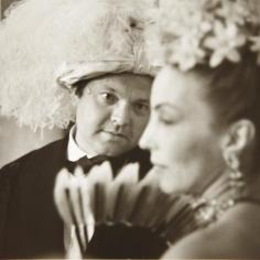 Orson Welles, whose costume had not arrived on time and who wore a curly blond wig and a tuxedo with Mademoiselle Aimée de Heeren. Photograph by Ruth Orkin.